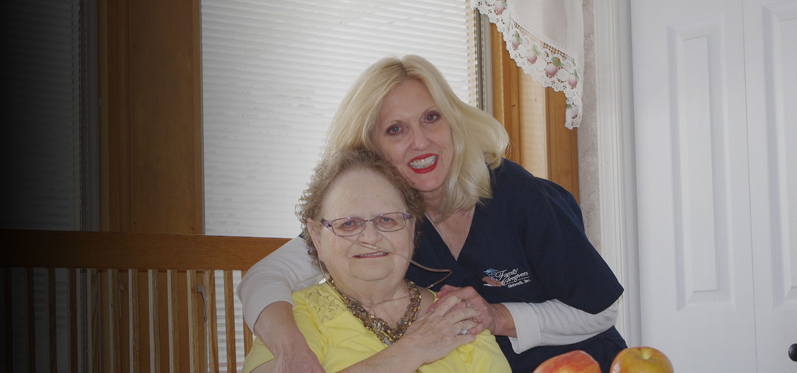nurse smiling with an elderly person