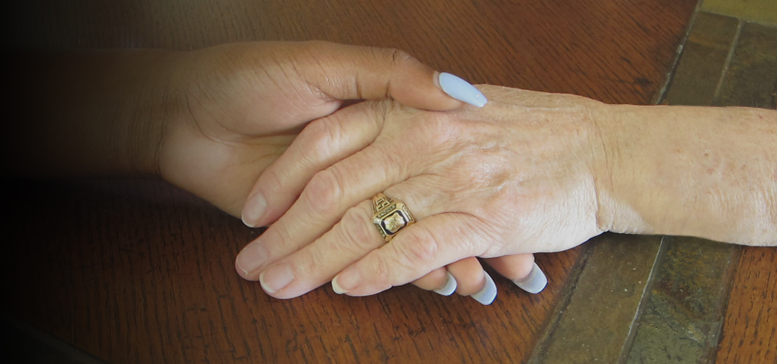 two peoples hands holding each other